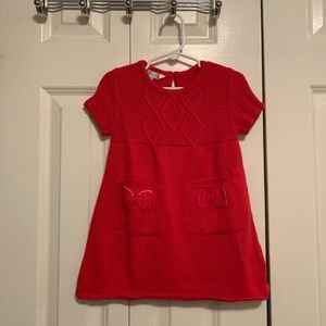 Red toddler sweater dress; pocket & bow details